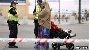 Norwegian police take the details of a Muslim woman near the Oslo train station after a bomb scare - 27 July 2011