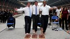 "Hugh Robertson, Lord Coe and British Olympian Colin Jackson celebrate ""One year to Go"" by getting their footprints cast"