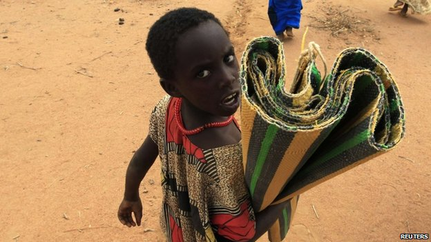 A girl arrives at a refugee camp in Kenya