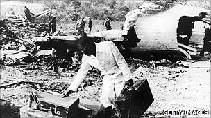 Men sift through the wreckage of an Air Rhodesia Viscount shot down by a terrorist missile in 1978 