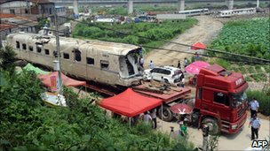 The wreckage of high-speed train carriage is carried on a truck in Shuangyu, on the outskirts of Wenzhou, Zhejiang, 26 July 2011