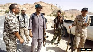 Libyan rebel fighters prepare to make their way to the front line on the outskirts of Nalut