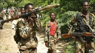 Somali government troops patrol sections of a front line in Mogadishu on 28 July 2011