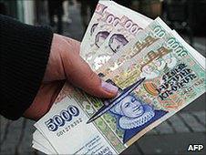 A man holds some Icelandic Krona