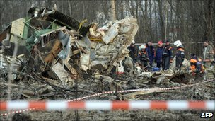 This photo taken on April 11, 2010 shows Russian rescuers inspecting the wreckage of a Polish government Tupolev Tu-154 aircraft near Smolensk airport