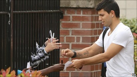 Sergio Aguero signs autographs after completing his medical