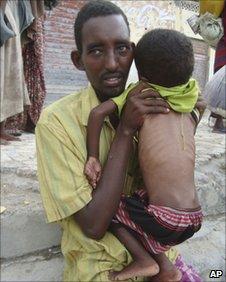 Somali man and child