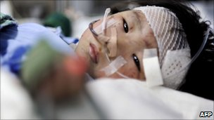 Injured child in hospital, 25 July