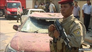 An Iraqi soldier at the site of a bomb attack in Diwaniya, south of Baghdad, 21 June