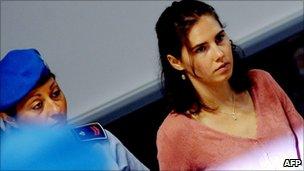 Amanda Knox being led into court