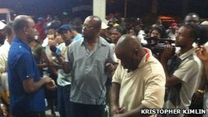 President Bharrat Jagdeo (left) speaking to reporters at the airport (image from Kristopher Kimlin)