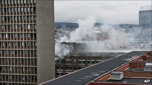 Smoke rises over Oslo after the bomb attack on 22 July