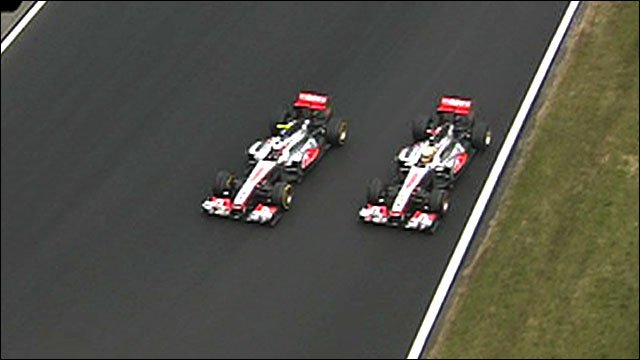 Jenson Button overtakes Lewis Hamilton