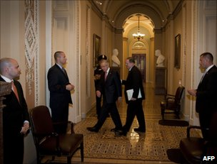 Senator Harry Reid (left) walks back to his office from the Senate chamber, 30 July
