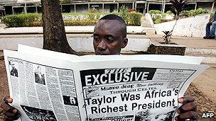 Newspaper reader in Sierra Leone