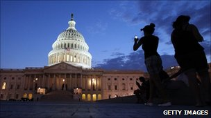 Tourists photograph the US Capitol building