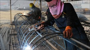 Chinese workers weld in East China