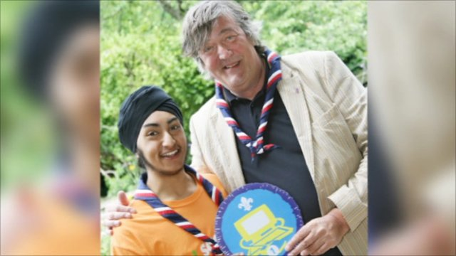 Stephen Fry receiving an honorary Scout badge for IT from Simrit Kudhail