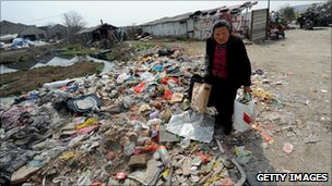A Chinese woman collects recyclable materials