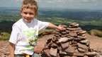 Tomos, six, from Auckland, New Zealand, who climbed Corn Du, as seen, and Pen y Fan, in Brecon Beacons National Park, with his father, Matt, who is from Wales.