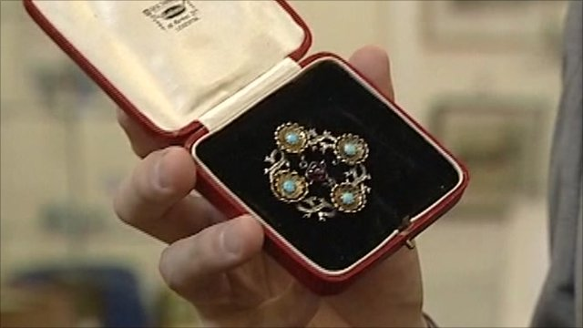 The brooch by William Burges in a box