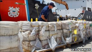A US Coast Guard crew member inspecting the narcotics in Florida