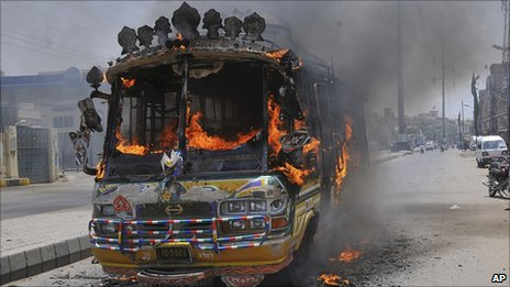 A bus burning in Karachi, 1 August 2011