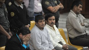 Carlos Antonio Carias Lopez, Daniel Martinez Martinez, Reyes Collin Gualip and Manuel Pop Sun (from left to right) during their trial on 1 August 2011