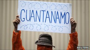 A supporter of former Guantanamo Bay inmate Australian David Hicks protests outside the Supreme Court in Sydney