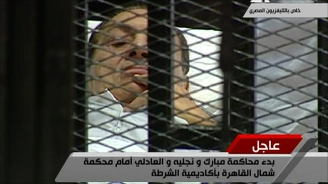 Egyptian state TV pictures of Hosni Mubarak on his stretcher in court