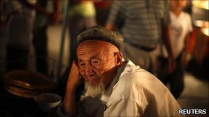 An ethnic Uighur man sits at a local market in Kashgar, Xinjiang