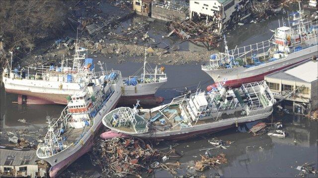Damaged ships are seen after a tsunami and earthquake in Kesennuma City in Miyagi Prefecture, Japan