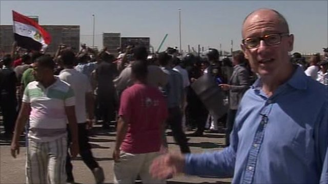 Jon Leyne watching protesters in Cairo