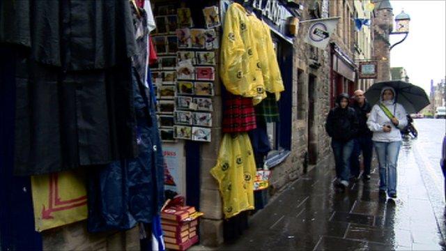 People walking past a shop selling souvenirs