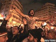 Protesters celebrate the news of Mubarak's resignation
