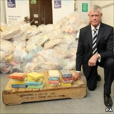 Brodie Clark, head of the border force for the UK Border Agency, with some of the drugs recovered