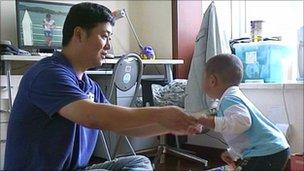Wu Hong Jiang and his son