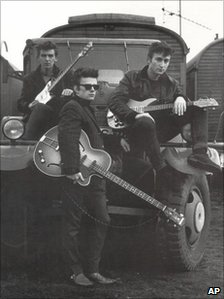 John Lennon with George Harrison and Stuart Sutcliffe in Hamburg in 1959