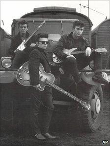John Lennon with George Harrison and Stuart Sutcliffe in Hamburg in 1959