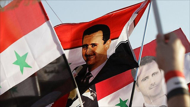 President Assad depicted on national flag of Syria
