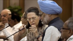Indian Prime Minister Manmohan Singh, second right, listens to Congress Party President Sonia Gandhi in Delhi, 3 July 2011.
