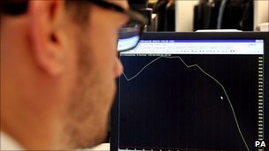 Man looks at screen with FTSE falls since mid-July