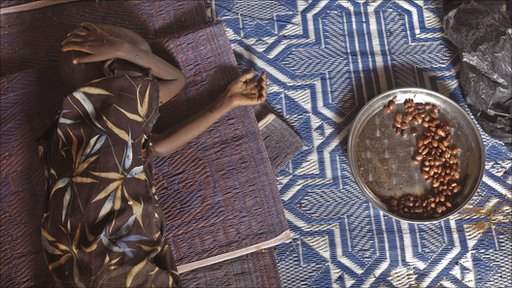 A displaced child lies on a mat at Dadaab refugee camp, Kenya