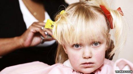 Child having her hair done