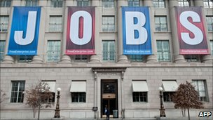 "The US Chamber of Commerce with a sign reading ""jobs"" hanging on the building"