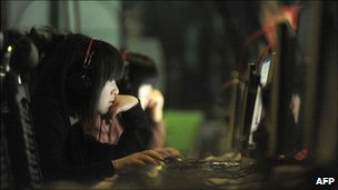 This photo taken on May 12, 2011 shows people at an internet cafe in Beijing