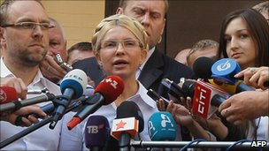 Ms Tymoshenko - pictured here before her arrest - addresses the media in front of the court building on Friday