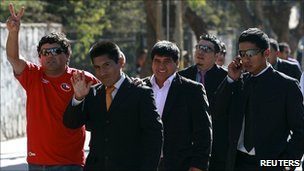 Five of the rescued Chilean miners outside the church service