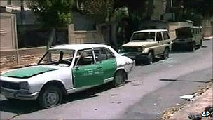 State TV images show damaged cars in Hama. 4 Aug 2011