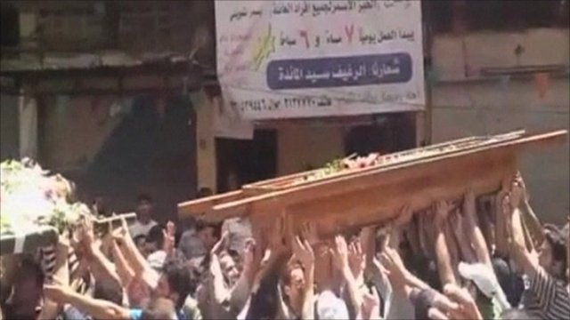 People carry a coffin in Syria
